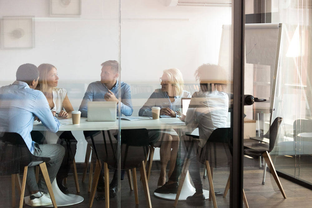 Business people negotiating as a team in conference room